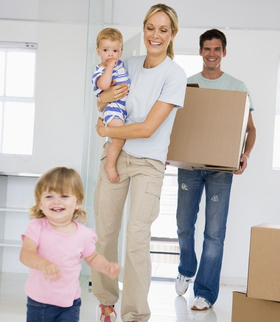 Young Family Moving Into New Home